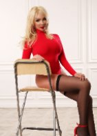 Angie , an escort from 100 Kisses Escort